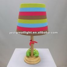 Creative printed colorful table lamp with wood base and dinosaur decoration