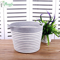 Decorative woven cotton rope storage basket with handles
