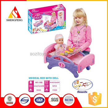 Children play doctor toy for the nursing bed with the doll