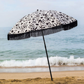 round luxury beach umbrella with tassels