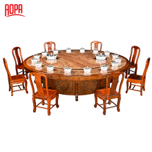 Solid wood tempered glass rotating dining table