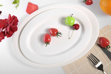 Haonai hotel dinner plate white porcelain/ceramic dinner plate oval shape flat plate for dinning,party