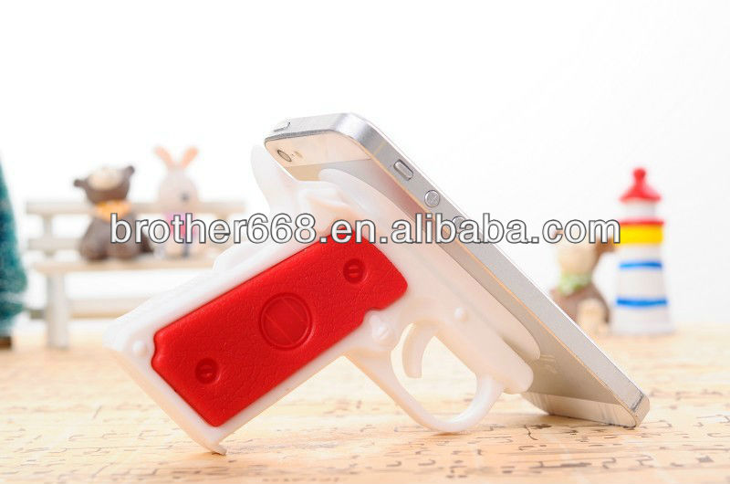 new design hot fashion Gun shape silicone sucker gun stand holder for pad ,Mobile gift , phone accessory