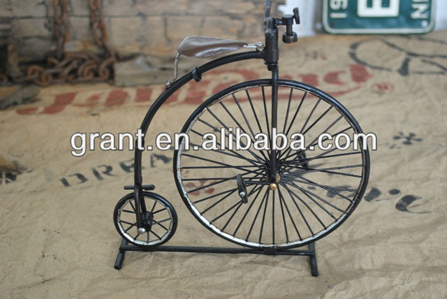 Antique metal bicycle model in art