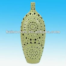green glazed ceramic pierced flower vase