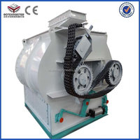 Quick mixing single shaft horizontal grain feed mixer