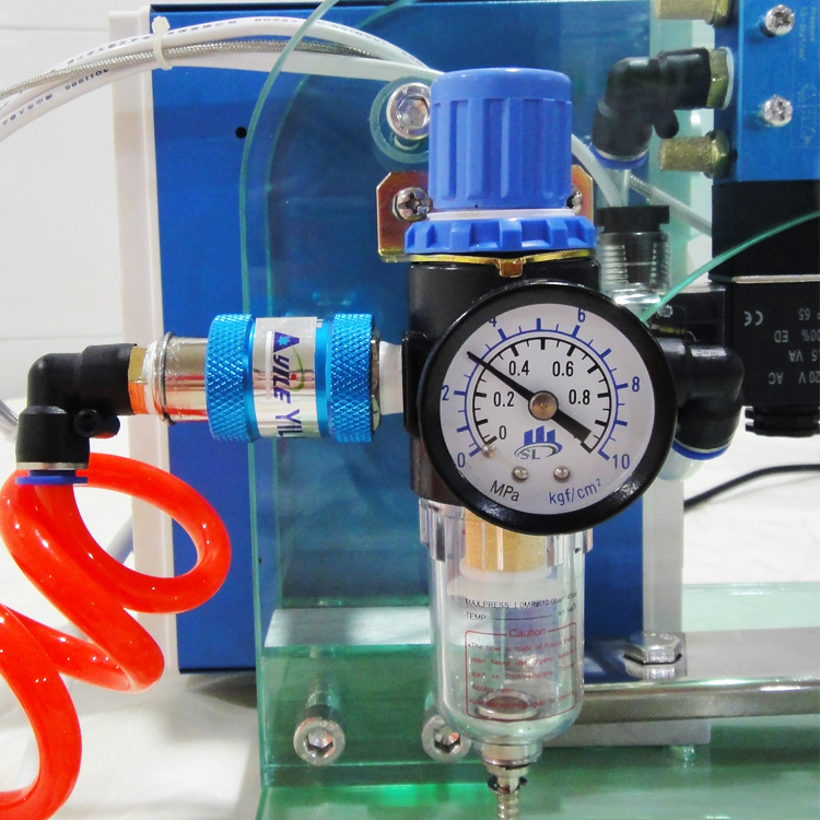 Coffee valve applicator machine for one way degassing valve