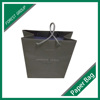 CUSTOM MADE BLACK PAPER BAG FOR GIFTS PACKAGING WITH PP HANDLES