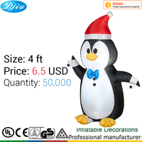 Christmas Penguin inflatable decoration with red hat