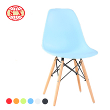 modern plastic dining chair with wooden legs