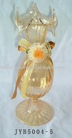 glass vase with ribbon flower