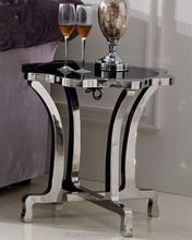 Irregular end table with stainless steel base for sale