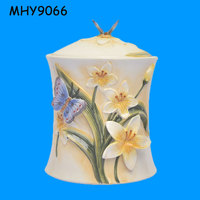 lily flower ceramic cookies container with butterfly