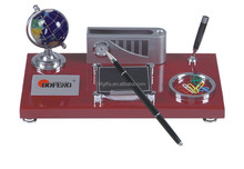 wooden desktop with ball and electric pen holder for office