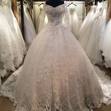 Heavy Hand Made Beaded Long Sleeves Lace Ball Gown Wedding Dress with Chapel Train