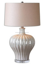 Ribbed ceramic table lighting in an iridescent pearl glaze accented with a crystal foot round hardback linen fabric drum shade
