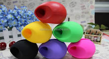 Promotion egg shape silicone cell phone stand speaker with logo