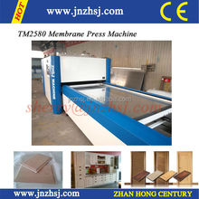 TM2580G membrane press machine for high glossy PVC and veneer with cabinet door .