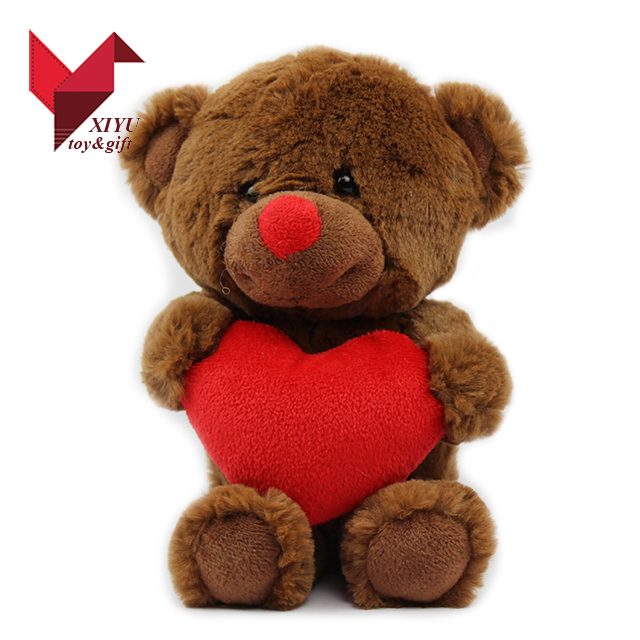 teddy bear plush toy with red heart as valentine gift