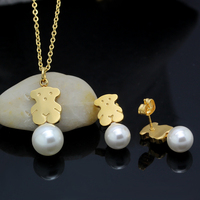 New winter fashion wild female pearl pendant clavicle chain necklace pearl earrings bear stainless steel