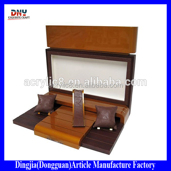 brown wooden bracelet watch display