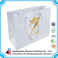 Wholesale alibaba reusable white gold foil paper shopping bag