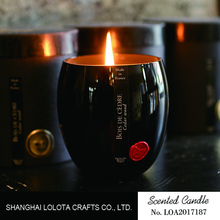 Luxury scented candle in unique black glass jar for decoration