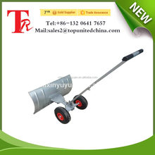 Adjustable heated push snow shovel with two wheel