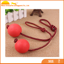 Solid rubber ball with rope for dog
