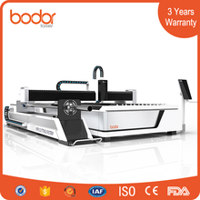 2500W metal tube sheet laser cutting machine 1500*3000mm with exchange table tubing rotary 3 years warranty
