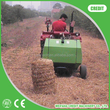 TRACTOR MOUNTED MINI ROUND HAY BALER