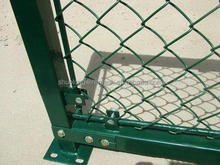 Temporary chain link fence top barbed wire