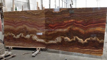 Red Tiger Onyx bookmatched big slabs