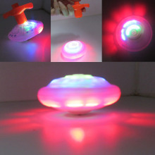 Funny and plastic UFO shape spinning spin top toy with light and music