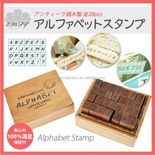 wooden antique handwriting alphabet stamp