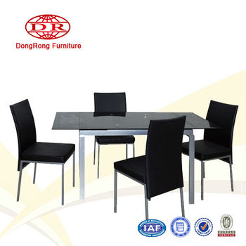 Space-saving extending dining room set with glass top