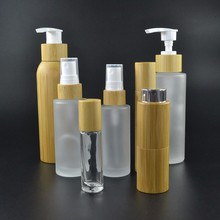 wholesales perfume essential oil 30ml 50ml 100ml 120ml 150ml frosted glass cosmetic bottle with bamboo spray or pump cap