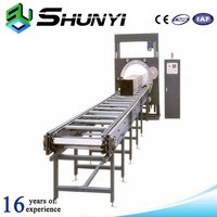 Horizontal furniture shrink wrapping machine