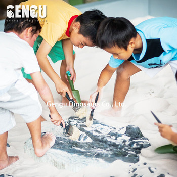 Children dig Dinosaur fossil site game