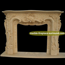 hand carved shell flower covering marble fireplace surround
