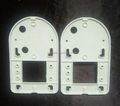 white injection plastic parts on machine