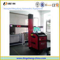 automotive wheel alignment with turntable and clamp
