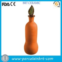 "Terracotta 10"" olla with decorative glazed leaf finial"