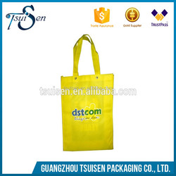 yellow non-woven bag with eyelet handles , shopping packaging pp non woven bag custom
