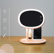 Folding LED makeup mirror and table lamp with mobile phone stand