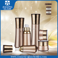 Shine Cosmetic Glass Bottles and Gold UV Cap Cream Jar