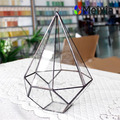 Geometric hanging glass terrarium for artificial plant and home decor.