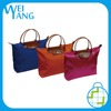 China suppliers folding travel tote polyerter fabric synthetic leather bag