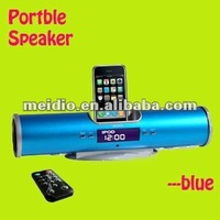 Portable docking station with alarm clock and FM radio