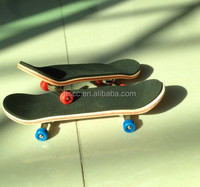 Latest Design Imported Canadian maple Wood Fingerboard Graphics back side bearing wheels Maple wood skateboard deck